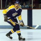 """Signed as a free agent in August 1977 after three seasons with the California Golden Seals/Cleveland Barons franchise, Charlie Simmer played eight seasons for Los Angeles from 1978-1985, twice earning All-Star nods.  During his tenure, he produced 222 goals and 244 assists for 466 total points in 384 games and was the left wing on the """"Triple Crown Line"""" with Marcel Dionne and Dave Taylor. The high-point of his Kings career: back to back 56-goal seasons in 1979-80 and 1980-81. He ranks eighth on the Kings' all-time scoring list."""