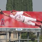 """A billboard of Darin Erstad and the Anaheim Angels overlooks the 10 Freeway in East Los Angeles. In 2005, owner Arte Moreno changed the team's name to the """"Los Angeles Angels of Anaheim"""" to try to draw more fan support from greater Los Angeles."""