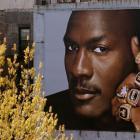 Michael Jordan showcases his six championship rings to E. 125th street in Harlem.