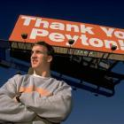 University of Tennessee senior quarterback Peyton Manning stands under a billboard thanking him for his four record-breaking seasons as a Volunteer. Manning was selected No. 1 overall by the Indianapolis Colts in the 1998 NFL Draft.