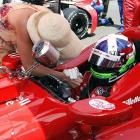 What husband hasn't enjoyed his spouse's commentary on his driving? Here, Mr. Franchitti receives an earful from Mrs. Franchitti before the 96th running of the Indianapolis 500 at the Indianapolis Motor Speedway in Indianapolis, Indiana.