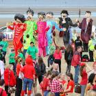 After presumably arriving via Yellow Submarine, Sgt. Pepper's Lonely Hearts Club Band, on stilts yet, entertained the gathering at Crosby Beach in Liverpool as part of ongoing gala pre-Summer Olympics festivities.