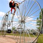 The bicycle designer, obviously a devout New Jersey Devils fan, takes the world's largest functional bike for a spin in Pudagla, Germany. The contraption is 7.80 meters long, 3.70 meters high, has a wheel radius of 3.32 meters and weighs 150 kilograms. You'll have to do the math if you want to know what that all comes out to in feet and pounds.