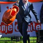 """We can't do any better than the caption that came with this photo from the Queen's Day festivities: """"Red-faced (  meaning it was flushed -- editor ) the Crown Prince Willem-Alexander of the Netherlands confessed to being ashamed of having taken part in the traditional Dutch potty-throwing contest, but organizers have pooh-poohed his objections. The heir to the Dutch throne ( nyuk, nyuk, nyuk -- editor ) was in the small eastern village of Rhenen where he won the game."""