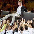 The former head coach of the German national handball team was rudely dragged out of his living room by his players and deposited at what would be his farewell match in Mannheim, Germany, June 3.