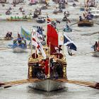 With the galley slaves huffing and puffing and rowing to the rhythm of the lash and the pealing of bells, the Royal barge Gloriana approached Westminster Bridge during Her Majesty's Diamond Jubilee Pageant on the River Thames in London on June 3.
