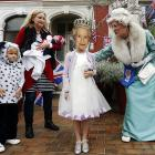 Meanwhile on short, celebrity lookalike Caroline Bernstein (right) was a dead ringer for the queen as she judged a fancy dress competition at the Goldsmith Avenue Street Party in London.