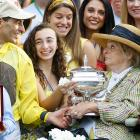 The jockey shockingly tried to relieve a woman of her silverware after winning the Belmont aboard Union Rags, who she just happens to own.