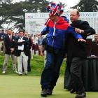 USGA director Mike Davis unceremoniously shoo'ed a rooster-headed heckler who committed the fowl deed of running on the course at the Olympic Club in San Francisco.