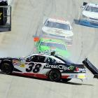 Brad Sweet (38) and Danica Patrick (green car) crash along the front straightaway during the Nationwide Series race in Dover, Del.