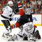 New Jersey's Patrik Elias face plants behind Los Angeles Kings goalie Jonathan Quick as Drew Doughty watches during Game 2 of the Stanley Cup Finals.