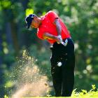 Tiger Woods plays the 18th hole during the last round of the Memorial.