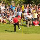 Fans cheer after Tiger Woods made an incredible chip from the rough for a birdie on the 16th hole of the 2012 Memorial Tournament. Tiger went on to win the tournament, his 73rd victory.
