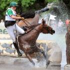 Lithuanian rider Aistis Vitkauskas falls from his horse Galopper during the German Eventing Championships in Luhmuehlen.