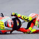 Italian rider Valentino Rossi crashes his bike on Saturday afternoon during the final qualifying session at the British Grand Prix.