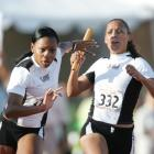 Jones passes the baton to teammate Monique Hall during the Texas Relays in Austin.