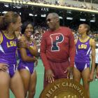 Bill Cosby chats with Jones and other members of the LSU women's shuttle hurdle relay team, including RaNysha LeBlanc, Tiffany Robinson and Brittany Littlejohn, at the 110th Penn Relays in Philadelphia.