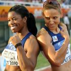Jones (right) and Perdita Felicien of Canada pose after the 400m hurdles during the IAAF Continental Cup in 2010. Jones finished second and Felicien third.