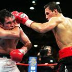De La Hoya became the first boxer in history to win titles in six different divisions -- a record later bested by Pacquiao -- when he outpointed Sturm, who held the WBO middleweight title. All three judges scored it 115-113 to De La Hoya, even though he'd connected on just 188 of 792 punches (14.9 percent) compared to 234 of 541 (43.3 percent) for Sturm.