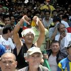 A fan give a thumbs down to protest Bradley's victory over Pacquiao.