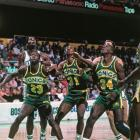 Olden Polynice, Derrick McKey, and Xavier McDaniel look to rebound against the Boston Celtics during a 1988 game. McDaniel was a first-round draft pick for the Seattle Supersonics in 1985, started immediately and proved to be a valuable asset to the team, averaging 21.4 points per game in the 1987-1988 season.