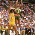 Dale Ellis shoots a jumper over Tony Campbell.  Ellis was the leading scorer on the team from 1986-87 until the 1989-90 season.