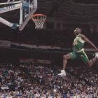 "Seattle power forward Shawn Kemp in mid-flight during the NBA Slam Dunk Contest in Charlotte, N.C., circa 1991. Though ""Reign Man"" was a six-time all-star, three-time participant in the dunk competition, and perhaps best remembered for his highlight reel jams, he never won the contest, taking second to Boston's Dee Brown at this particular competition."