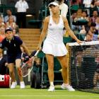 The former top-ranked female -- and current girlfriend of professional golfer Rory McIlroy -- looked dejected after her disappointing first-round upset. Ranked No. 7 in the world, she dropped a tough three-setter to Austrian Tamira Paszek, No. 37 in the WTA rankings. The 21-year-old Dane had not experienced as early an exit from a Grand Slam in more than five years.