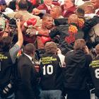 Tyson handlers' attempting to restrain their fighter.