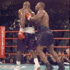 As Holyfield retreated to his corner, he is shoved by a frustrated Tyson.