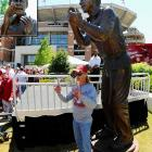 Standing icons around college football with their own statue.