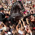 A rider and his bouncer brusquely made their way through a crowd of adoring fans in downtown Ciutadella on the Spanish island of Menorca.