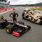 As Romain Grosjean proudly posed next to his Lotus E20 on Britain's Silverstone racetrack, Batman ominously trained a cannon on the unsuspecting driver from within the cozy confines on his Tumbler.