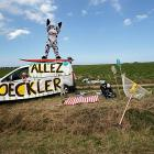 """A desperate cycling fan signaled for help -- we believe his sign means """"Out of Gas"""", but we don't speak French -- as the peloton roared through the fourth stage of the big bicycle race."""
