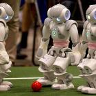 Three automatons at the big robot convention in Mexico City on June 22 paused to decide if they were playing soccer or bocce ball.