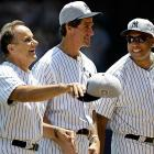 Former Yankees manager Joe Torre capped off a grand gathering of pinstriped greats -- that's Paul O'Neill and a rather robust Bernie Williams sharing in the mirth -- on July 1.