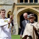Olympic torchbearer Phillip Wells kindly offered to light Her Majesty's cigar outside Windsor Castle.