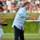 The Cubs hurler gave delivery tips to  The Hangover  star (right), who served up some hot ones to the erstwhile Ron Burgundy before they threw up the first slice, er, threw out the first pitch at Wrigley Field.