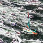 French skipper Franck Cammas leads his Groupama sailing team to victory in the Volvo Ocean Race in Lorient, France.  A huge entourage of spectator boats follow in the wake of the speedy sailboat to capture the moments after its win.