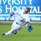 Blue Jays outfielder Jose Bautista made a diving catch on a ball hit by the Brewers Ryan Braun in the second inning.