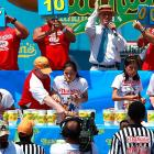 Sonya Thomas broke her own record by eating 45 hot dogs to take the crown.