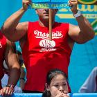 Thomas beat her own record by gobbling down 45 hot dogs and buns in 10 minutes to win the women's competition.