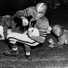Paul Brown's perfect quarterback: Under Graham the Browns played in 10 straight titles games and won four AAFC and three NFL Championships. He wore No. 14 from 1952 to 1956, leading the league in passing in '52 and '53.   Runner-up:   Y.A. Tittle    Worthy of consideration:   Ken Anderson, Steve Grogan, Don Hutson, Ed Podolak