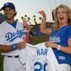 Andre Ethier is presented with a Mary Hart bobblehead doll by the television personality herself during a 2011 game at Dodger Stadium.