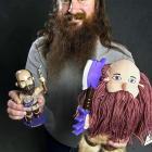 Minnesota Vikings mascot Ragnar holds up his bobblehead and rag doll.
