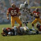 During Super Bowl VII in Los Angeles, Hall of famer Chris Hanburger (55) stands above the fallen Larry Csonka (39) of the Miami Dolphins.  The Dolphins would eventually defeat the Redskins 14-7.