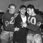 Quarterback Sammy Baugh, center, celebrates with teammates Cliff Battles, left, and Wayne Millner in the locker room after a win of the Chicago Bears in the National Football League Championship game in Chicago.  Millner scored two of the teams four touchdowns and Battles tacked on another in the Redskins 28-21 victory.