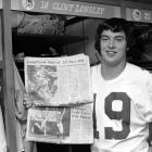 Dallas Cowboys' rookie quarterback Clint Longley shows off a newspaper report discussing his stellar performance in a 24-23 victory over the Redskins.  Longley was called upon in the third quarter after Roger Staubach was injured.  Longley led the Cowboys back from a 16-3 deficit and threw a last second 50-yard touchdown.