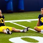 College football practices are notoriously tough. All these Wolverine linebackers need to complete the scene is a checkered cloth, a picnic basket and a nice bottle of wine.