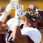 The Minnesota wideout tracks the flight of the three-year-old granddaughter from the preceding photo.